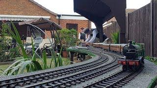 Family Create Miniature Railway In Garden