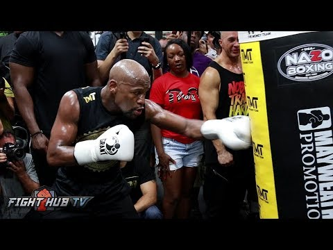 MASTER AT WORK! FLOYD MAYWEATHER THROWING BODY SHOTS FOR MCGREGOR ON HEAVY BAG!
