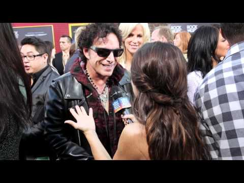 Neal Schon with Martha Quinn at the Rock of Ages Movie Premiere