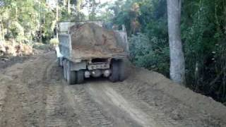 Dump Truck hauling half a load after rain cutting ruts