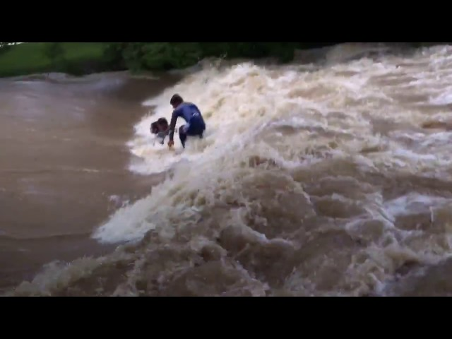 Surfers Dive Into Floodwaters Raging at Murwillumbah Weir
