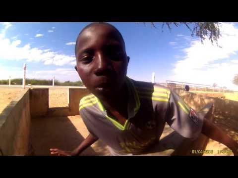 Senegal boy rapping at lake