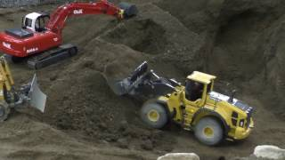CONSTRUCTION SITE, VOLVO WHEEL LOADER AND BULDOZER AT WORK