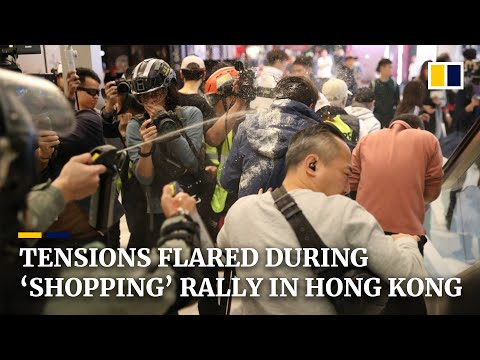Hong Kong protests: pepper spray fired during 'shopping' rally near border with mainland China