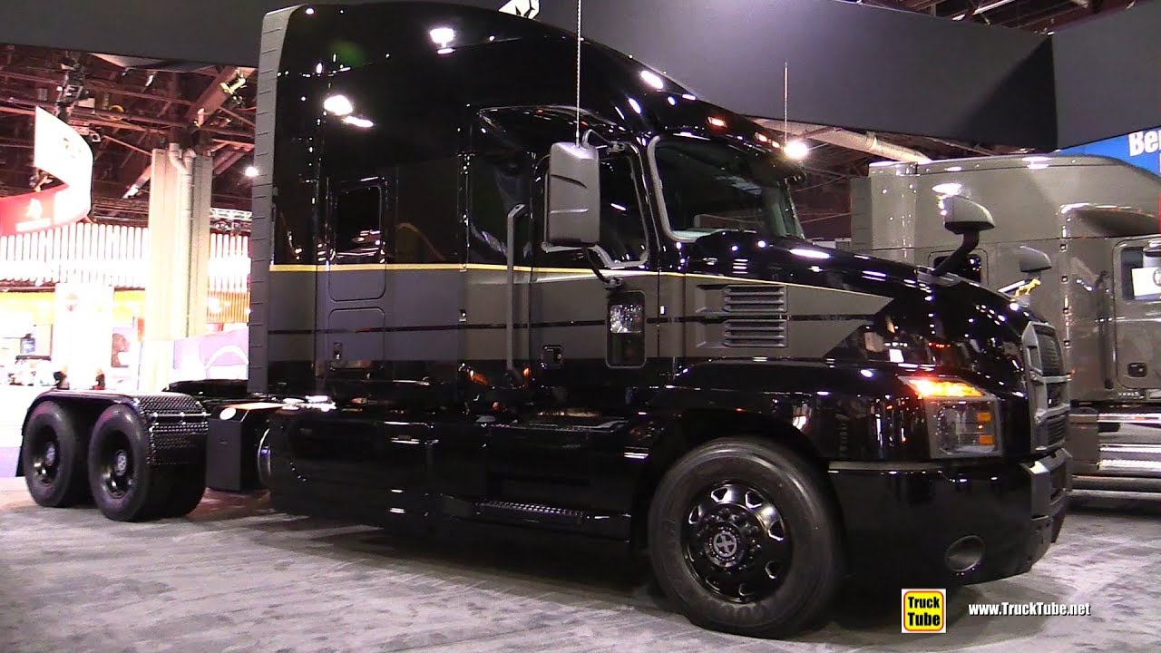 Intermat 2018 also 6923675950 additionally 2010 2014 Mustang Tail Lights Americanmuscle likewise 153 in addition Ford Louisville 8000. on international dump truck