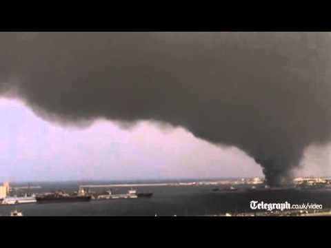 Black smoke rises above Tripoli