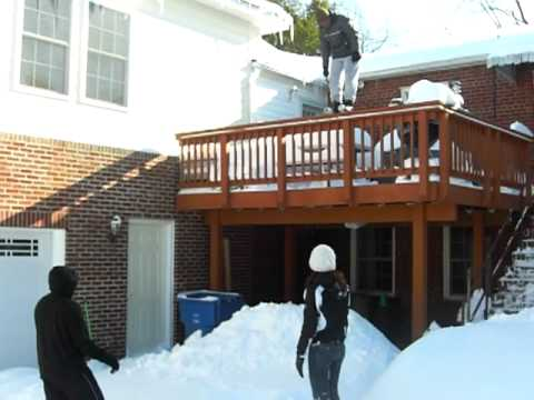 Dad jumping off a balcony...into the snow. - YouTube
