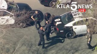 Pursuit driver in custody after ditching stolen van, getting into another vehicle in El Sereno area
