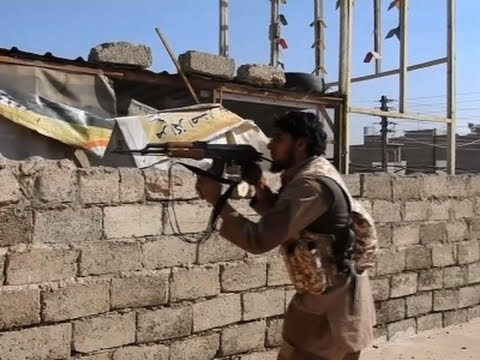 Raw: Militants, Iraqi Troops Fight for Mosul