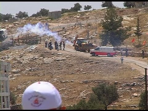 Demonstrations in Bil'in. Stones, tear gas