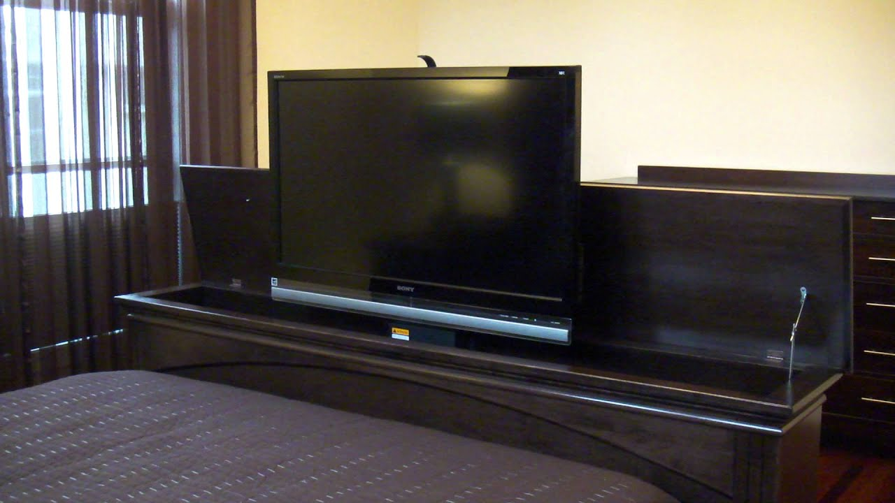 Tv lift foot board youtube for Foot of bed furniture