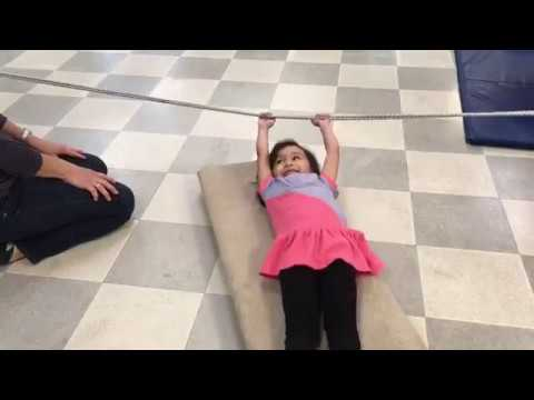 Occupational Therapy exercise helps girl improve strength and coordination