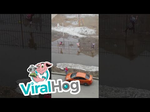 Thumbnail: Children Scale Fence to Avoid Flooding to Get to School