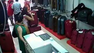 Lady Thief in Bag Shop