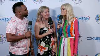 Miguel and Holly talk with Rita Ora at the AMAs