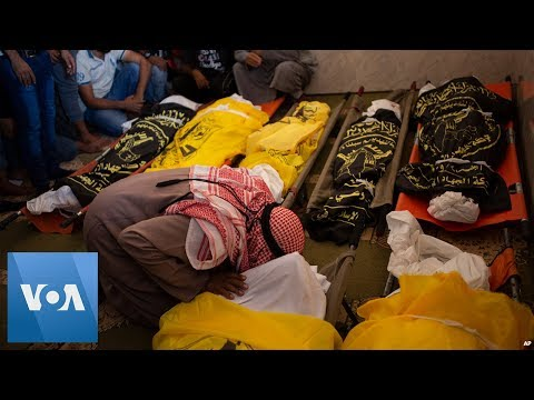 Palestinians Bury Family of Eight Killed in Fighting