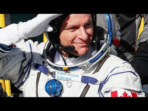 Canadian astronaut and Soyuz crew docks with ISS