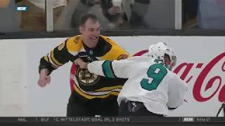 Zdeno Chara fights Evander Kane after a high hit, on February 26, 2...