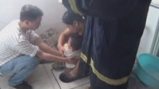 China: Boy gets stuck in squat toilet