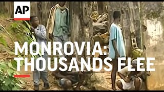 LIBERIA: MONROVIA: THOUSANDS FLEE AS FIGHTING CONTINUES thumbnail