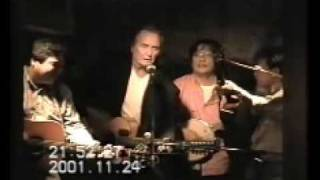 "Nov. 24th, 2001 in Japan John sang his part, ""I wave my hand to tin..."