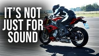 Why do motorcycle riders blip the throttle?
