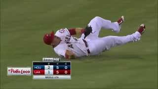 Trout charges to rob Gonzalez of a hit