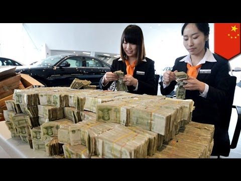 Man buys car with 120,000 one-yuan bills in China