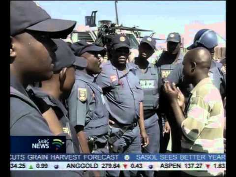 Police are keeping a watchful eye on striking Lonmin miners in Marikana.