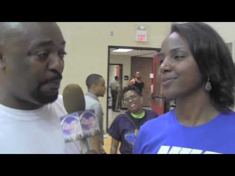 St. Louis Surge season ticket holder Angela Lewis speaks with Palmer Alexander III