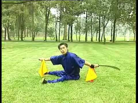 Shaolin kung fu ground-tumbling (di tang) twin sabers