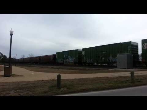 Caterpillar tractor on the front of a BNSF mixed freight, Norman, Oklahoma 3.14.2015