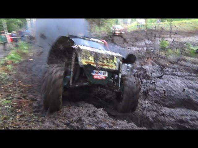Off-Road vehicle mud race in forest