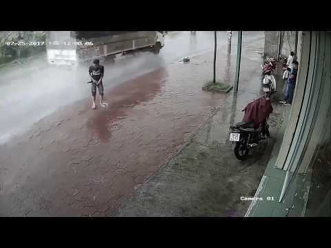 Man pees in the street and ...