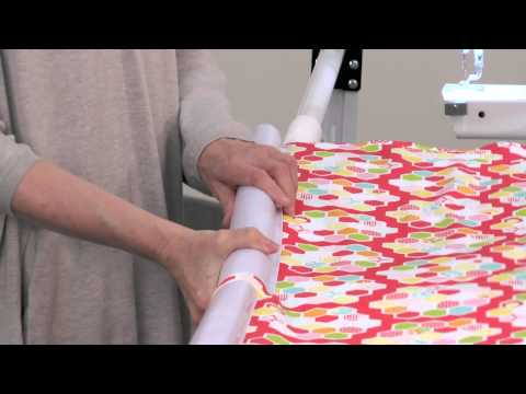 loading the quilt fabric on an SR-2 Quilting frame