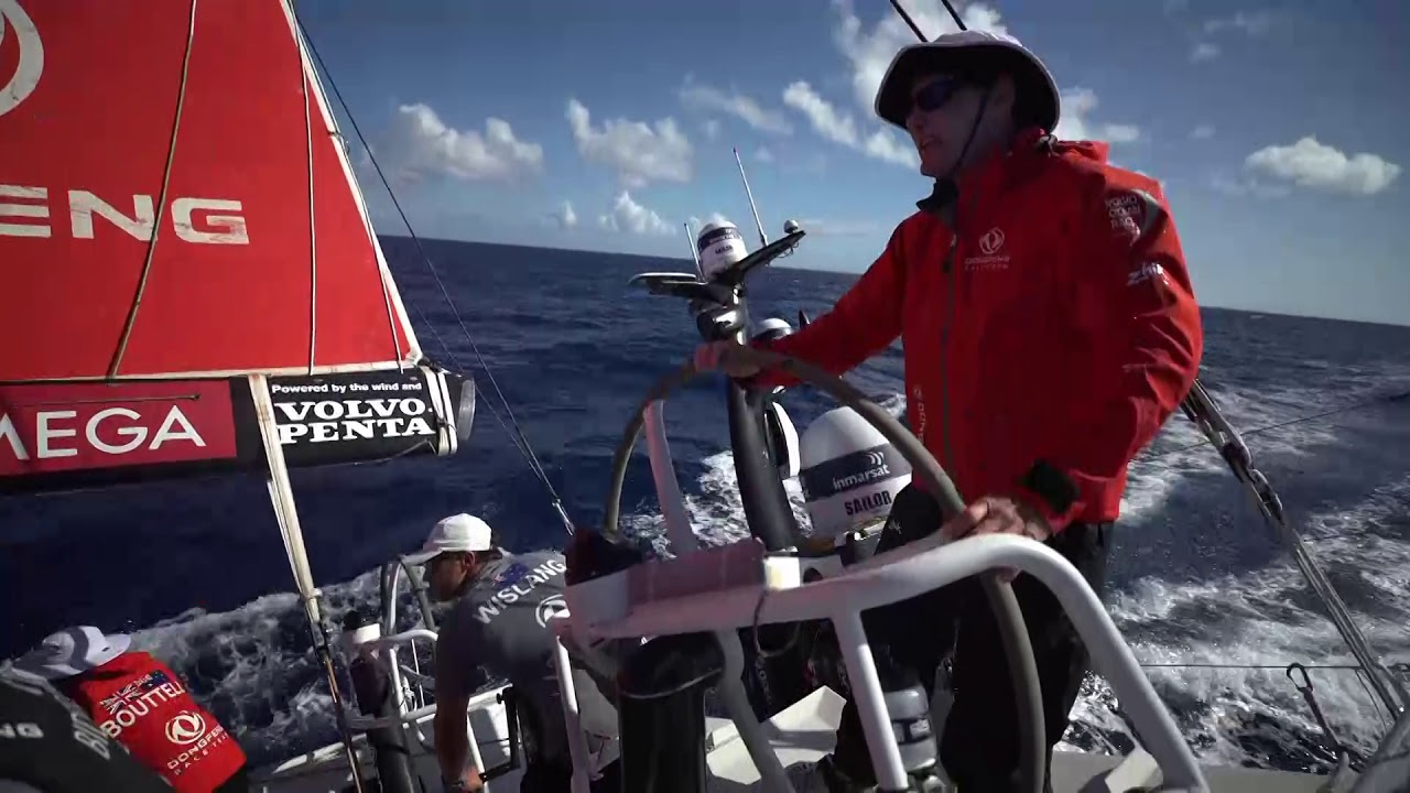 Horace talks about missing the team after being away. Now he's on board again, so he's happy. Daryl and Carolijn discuss tacking to avoid a cloud. Shifting the stack to leeward. We see the tack with Charles on the helm. Pascal, at the nav station, talks in French. On deck, Charles says that MAPFRE appears to be preparing to tack. Daryl, on the helm: A classic upwind slog. Probably 6 days. Everyone back there. (Gestures aft.) Good mood on board. Kevin talks about the clouds and wind shifting. And about seeing a cargo ship in his face while driving in the night. Drone shots after sunset showing the three competitores sailing (Dongfeng, MAPFRE, and TTToP.)