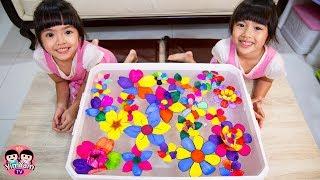 หนูยิ้มหนูแย้ม   ทำดอกไม้กระดาษบานบนน้ำ