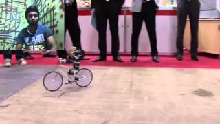 PRIMER V2 robot rides a bike just like a man