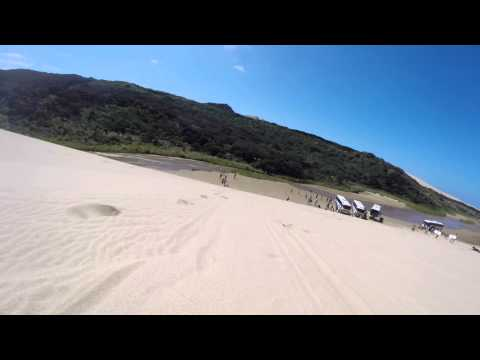 Sandboarding at 90 Mile Beach in New Zealand