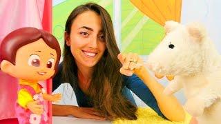 Eğitici çocuk oyunları - çizgi film oyuncakları. Niloya için Pet Shop'tan evcil hayvan alıyoruz!