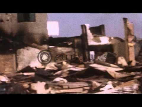 Vietnamese people look through rubble of buildings and houses in Bien Hoa, Saigon...HD Stock Footage
