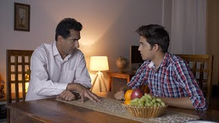 Indian teenage son and father at home - Serious discussing studies and career