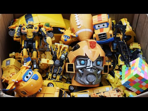 The box is full of yellow toys and cars - Bumblebee, Transformers Movie, Autobots Full Mainan Robot!