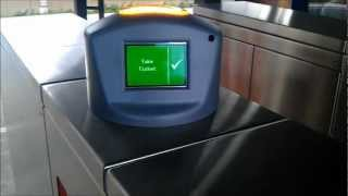 CityRail passing through Ticket barrier with newly fitted indicator for future OPAL smart-card 2