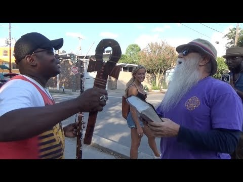 Egyptian Ankh merchant picks fight w/ Street Preacher!