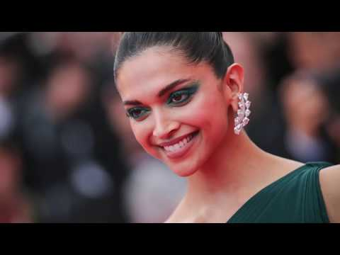 Deepika Padukone Looks Irresistibly Sexy in a Green Brandon Maxwell Gown At 'Loveless Nelyubov' Prem
