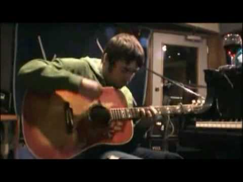 Oasis - Liam Gallagher playing guitar in studio