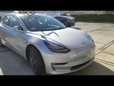 Tesla Model 3 with a bike on the roof
