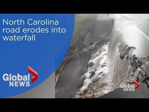 Rainfall turns eroding North Carolina road into waterfall