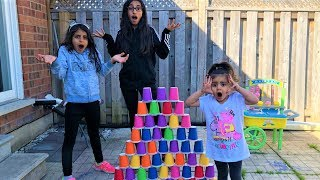 Kids pretend play Builds COLORFUL cup wall!! funny video